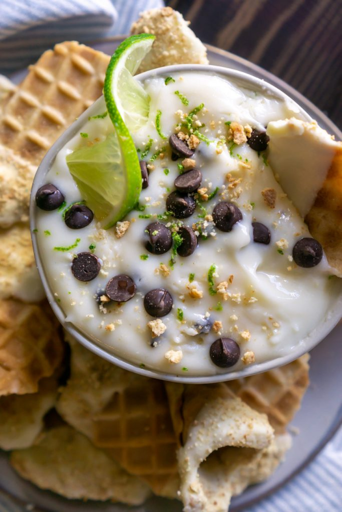 key lime pie cannoli dip in a bowl with a lime wedge