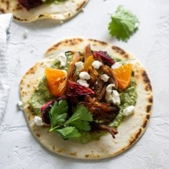 pork carnitas taco on a white background