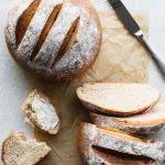 best whole wheat bread sliced on parchment paper