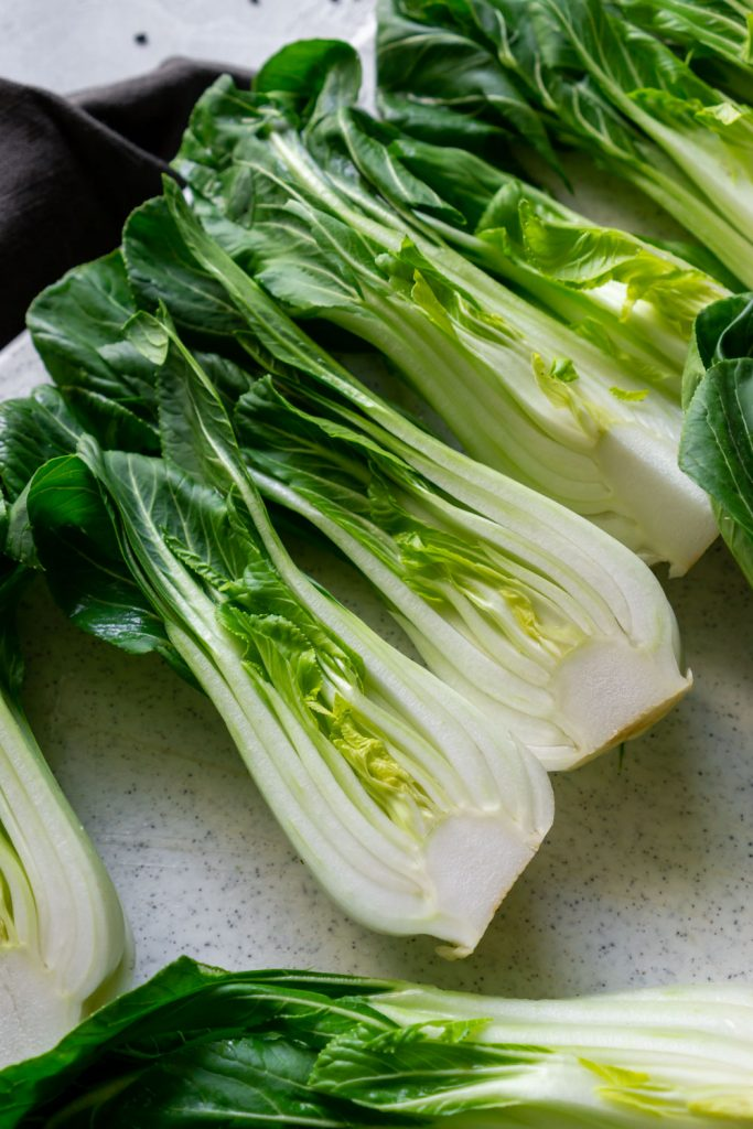 sliced bok choy on a white cutting board