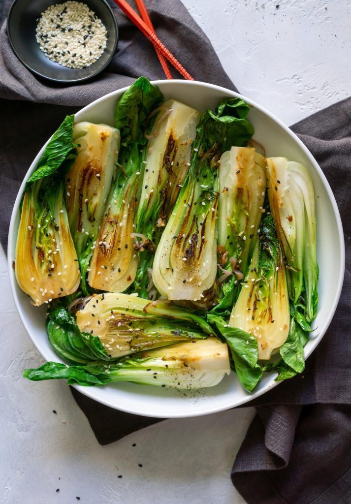 cooked bok choy in a white bowl