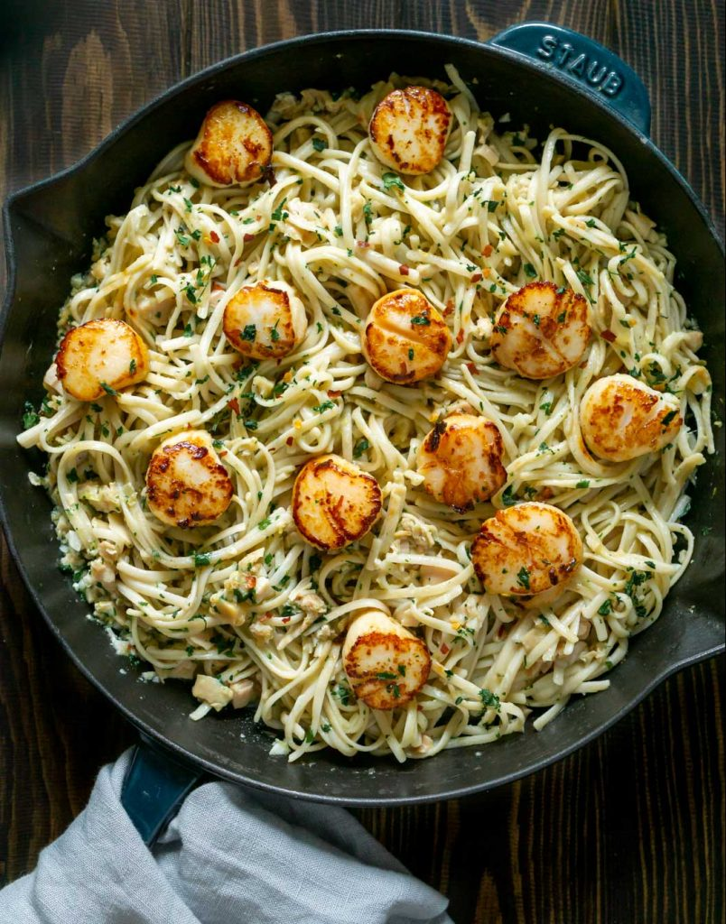 linguine with clam sauce and scallops in a pan