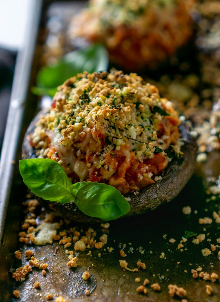 close up of an air fryer chicken parmesan stuffed mushroom