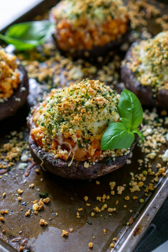 air fryer chicken parmesan stuffed mushrooms on a baking sheet with basil