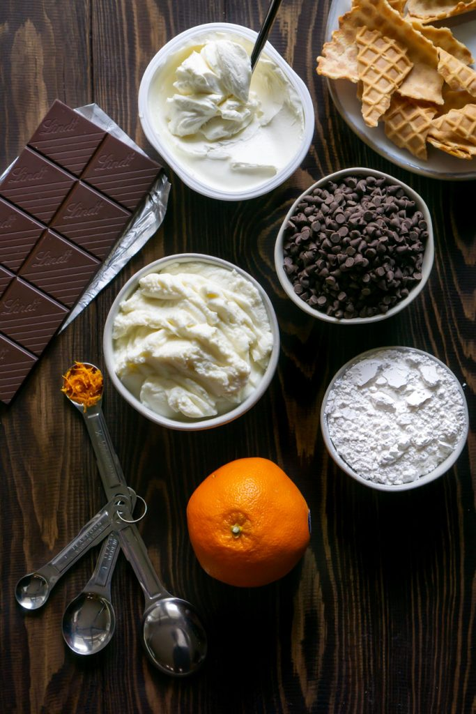 chocolate chips, ricotta cheese, an orange, and a chocolate bar