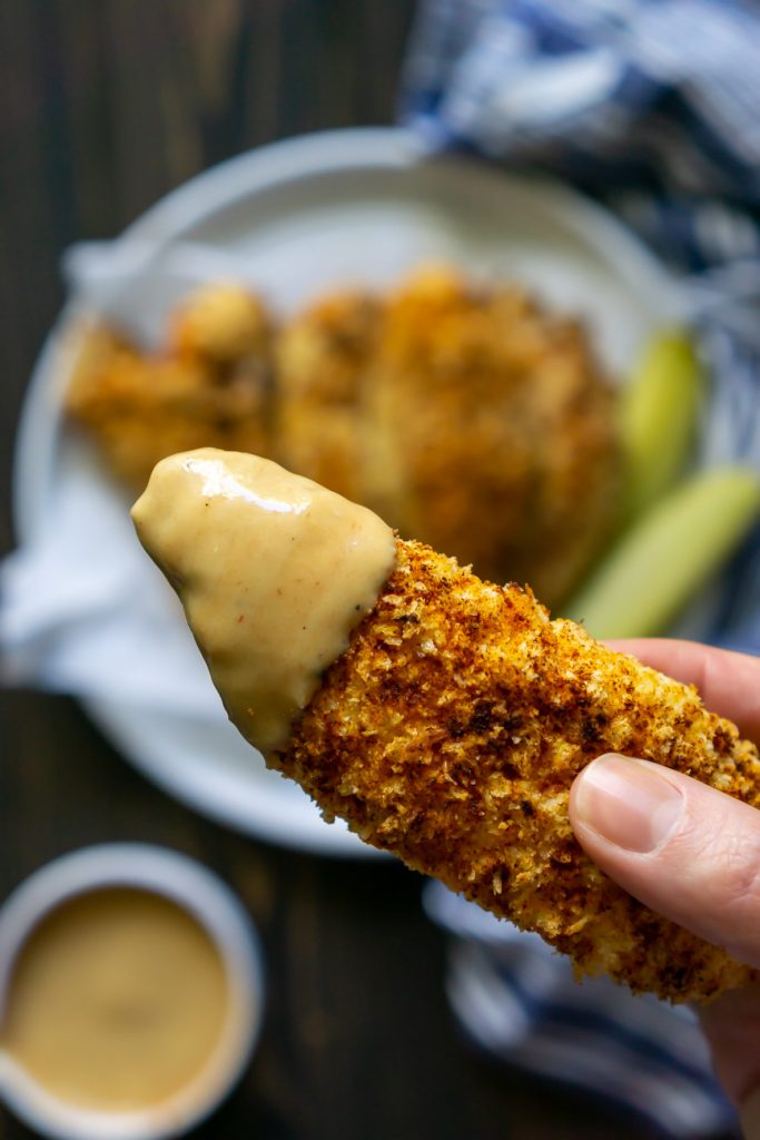 air fryer chicken tender dipped in chick-fil-a sauce