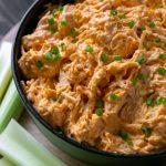 slow cooker buffalo chicken dip in a black bowl