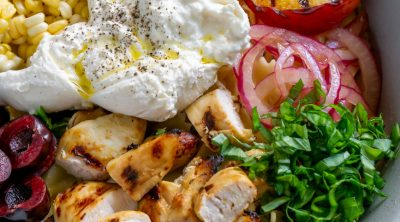burrata corn, grilled peaches, basil, and chicken in a large bowl