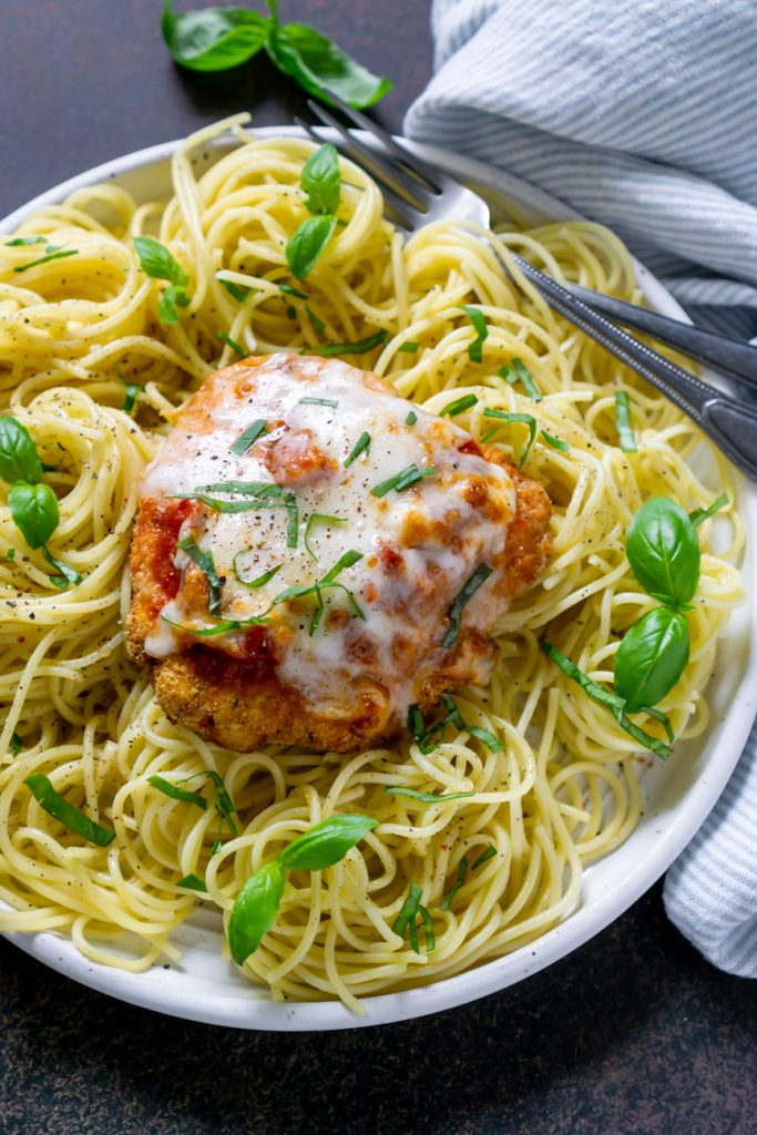 air fryer chicken parmesan with pasta on a white plate