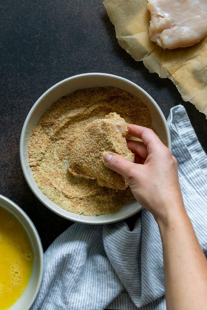 coating chicken in breadcrumbs