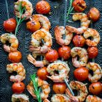 shrimp skewers on a dark surface