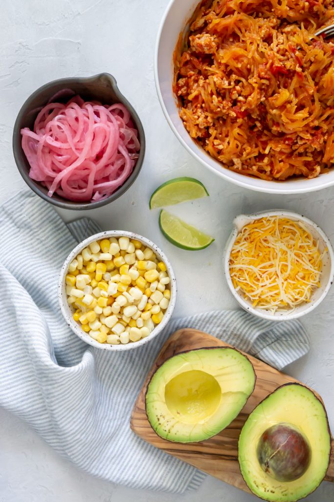 taco filling, corn, pickled onions, cheese, and avocado