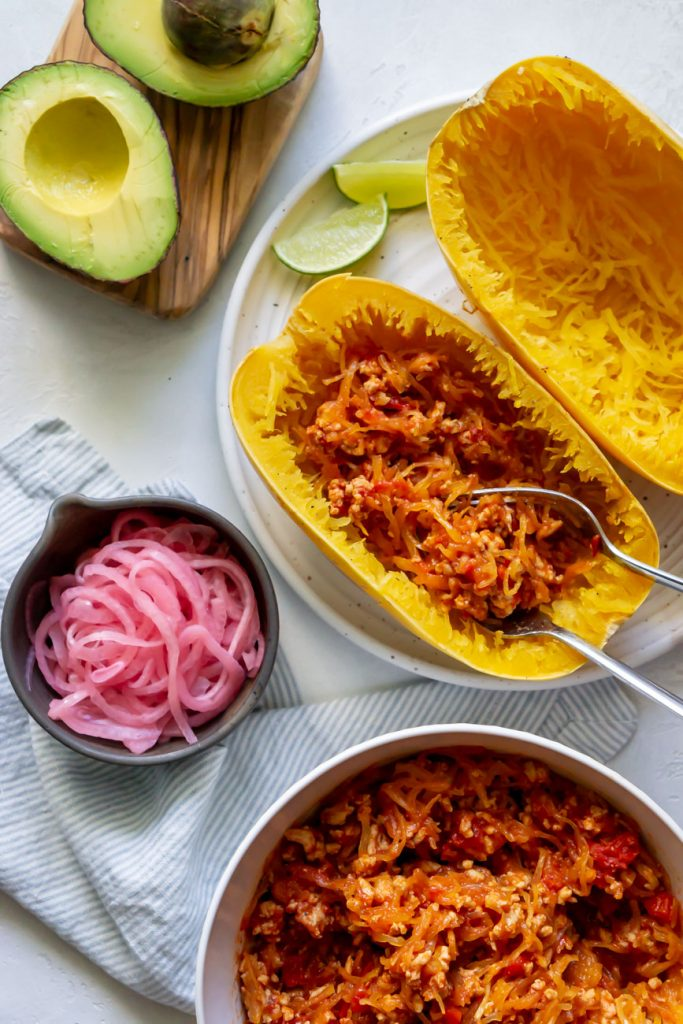 two forks with taco filling in spaghetti squash