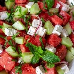watermelon feta salad in a large white bowl