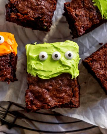 cake brownie with green frosting on a cooling rack