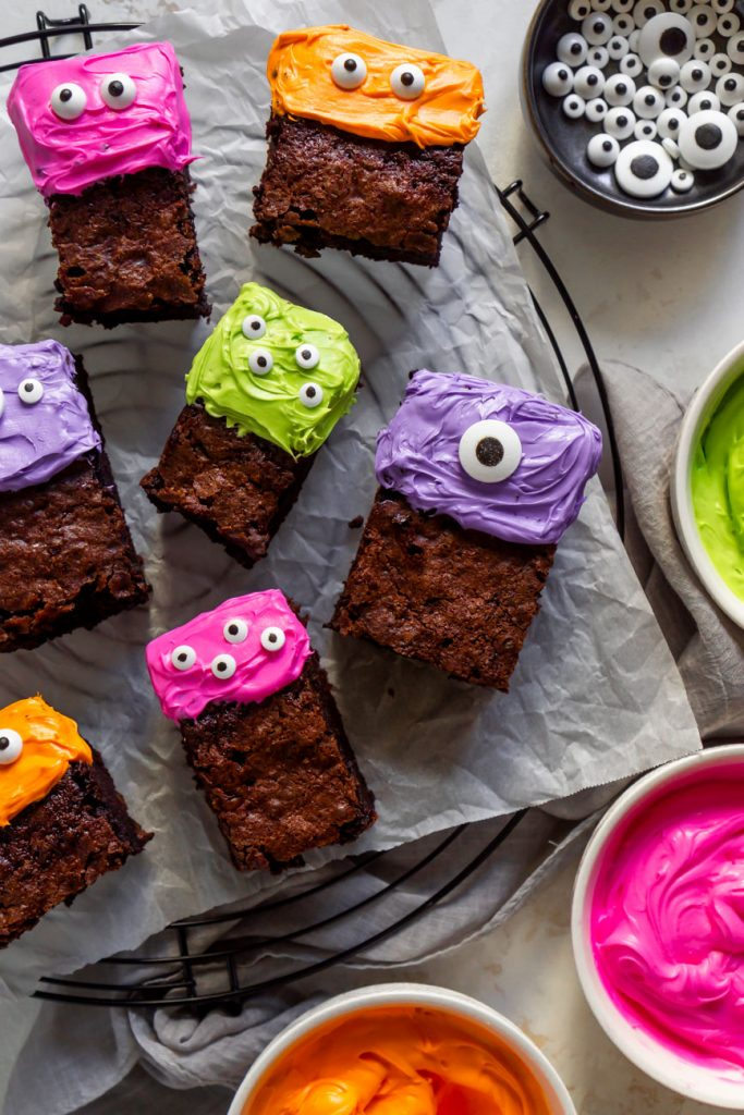monster cake brownies on a cooling rack with colored icing