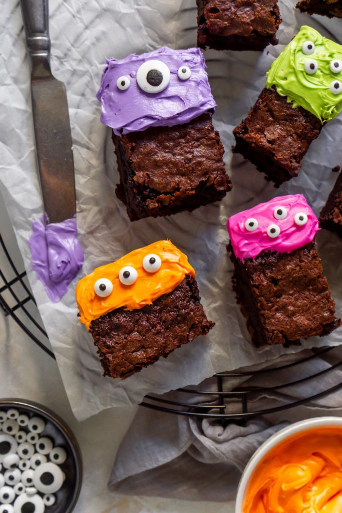 purple frosting on a knife with monster brownies