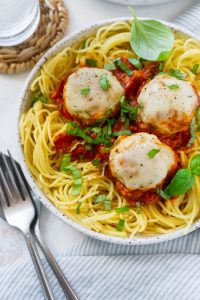 chicken meatballs on a plate with pasta