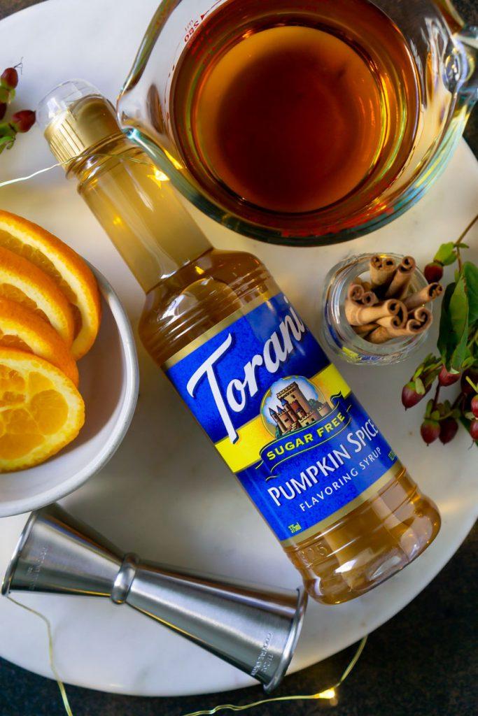 torani syrup, bourbon, and oranges