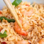 shrimp fried rice in a bowl with chopsticks