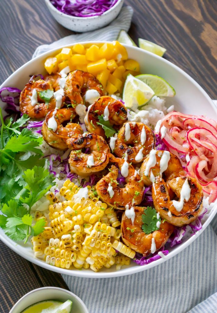 shrimp taco bowl with a blue striped napkin