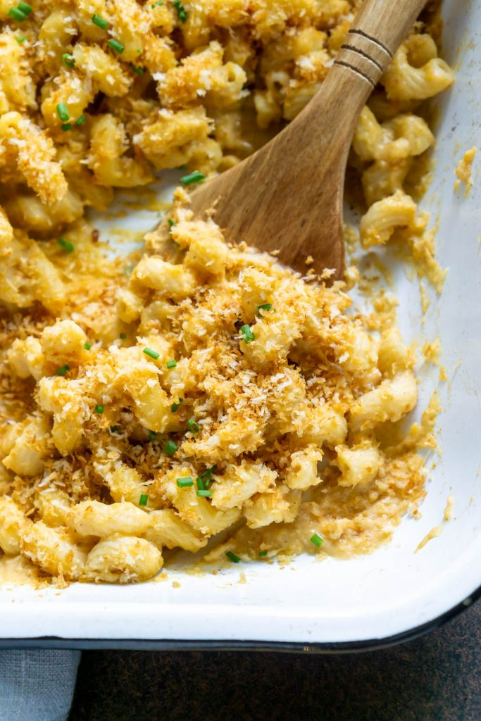 butternut squash mac and cheese on a wood spoon