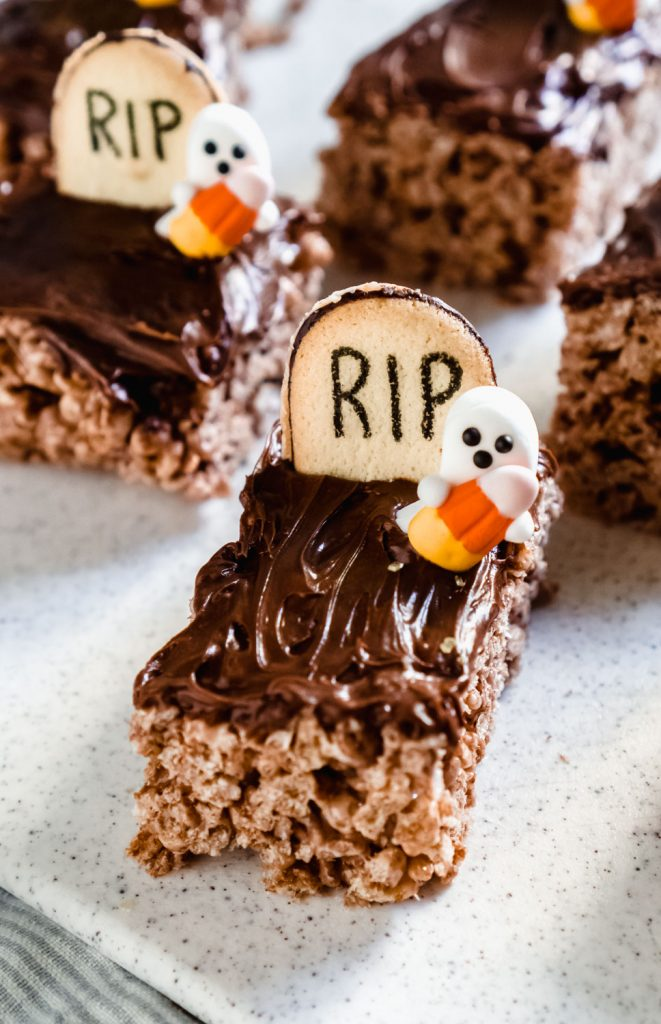 graveyard chocolate rice krispie treats on a white cutting board