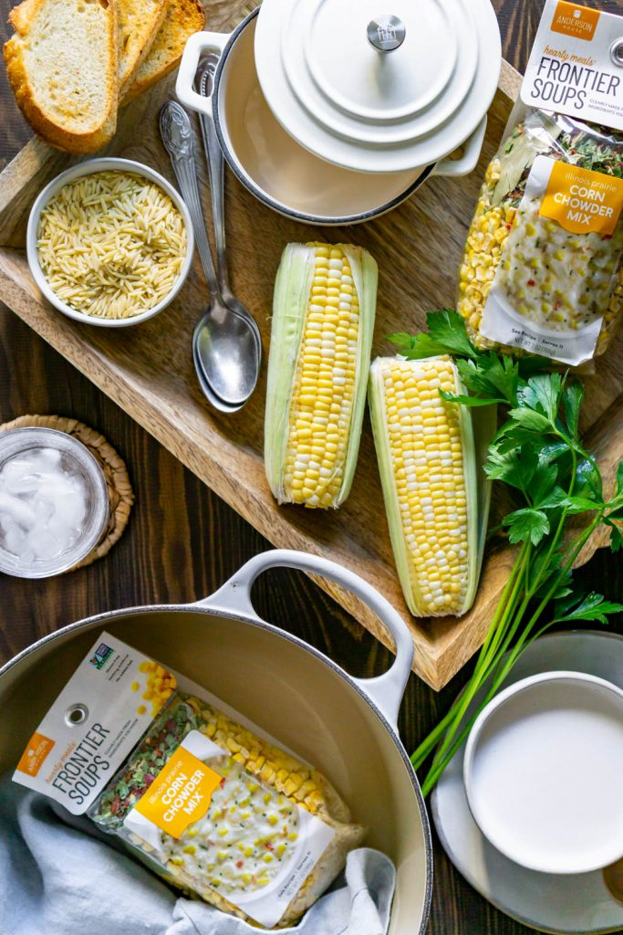 corn, wood tray, large pot, and toasted bread