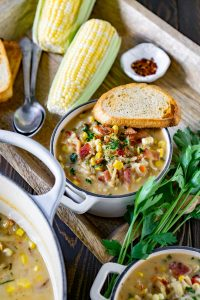 large pot of corn chowder and two small bowls