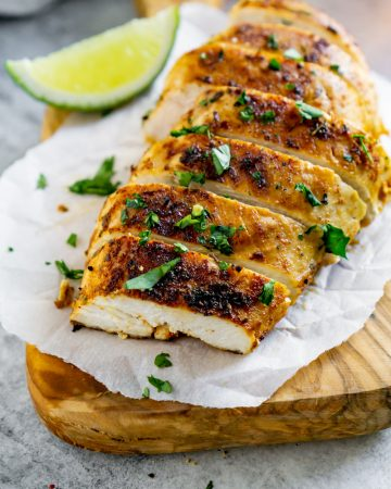 pan seared chicken with a lime wedge