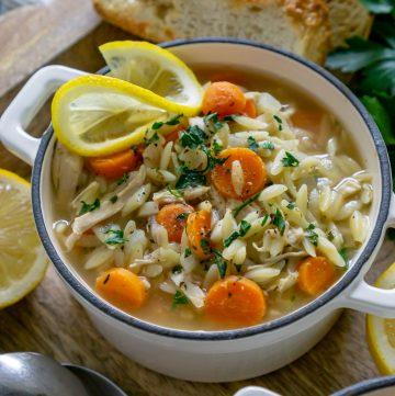 lemon orzo chicken soup in a white bowl