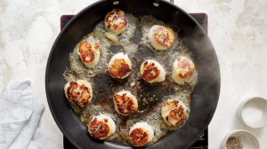 cooking scallops in a pan