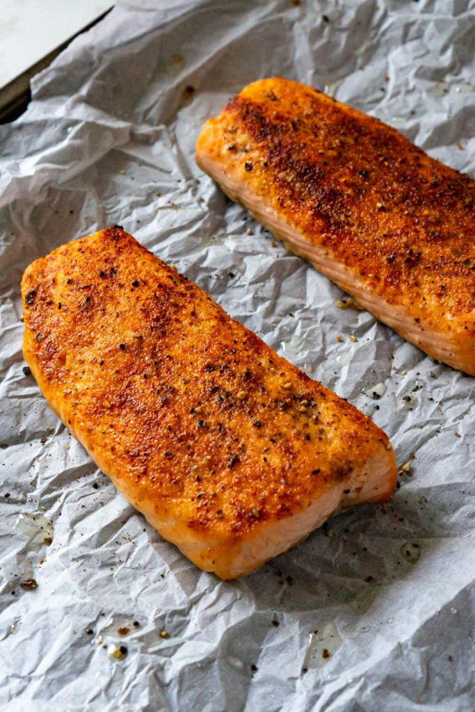 two fillets of cooked salmon