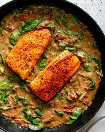 tuscan salmon in a cast iron pan