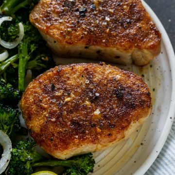 two air fryer pork chops on a white plate