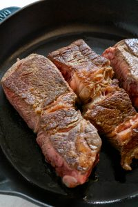 barbacoa beef seared in a cast iron