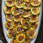 roasted yellow squash on an oval serving tray