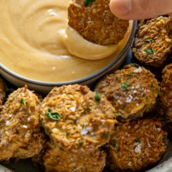 dipping fried pickles in spicy mayo