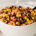 black bean and corn dip in a white bowl