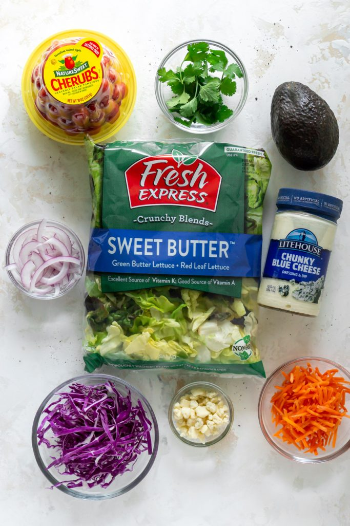 lettuce in a bag, dressing, tomatoes, shredded carrots, shredded purple cabbage, avocado, cilantro, sliced red onions