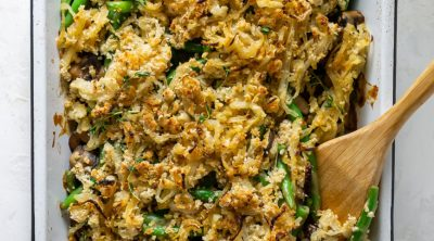 healthy green bean casserole in a white baking dish