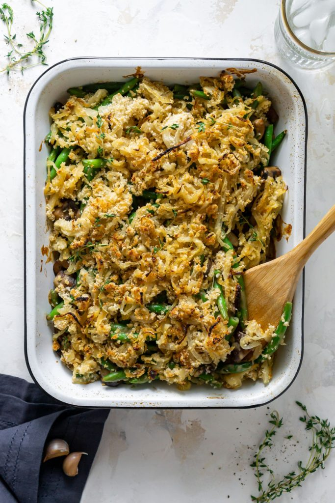healthy green bean casserole in a white baking dish