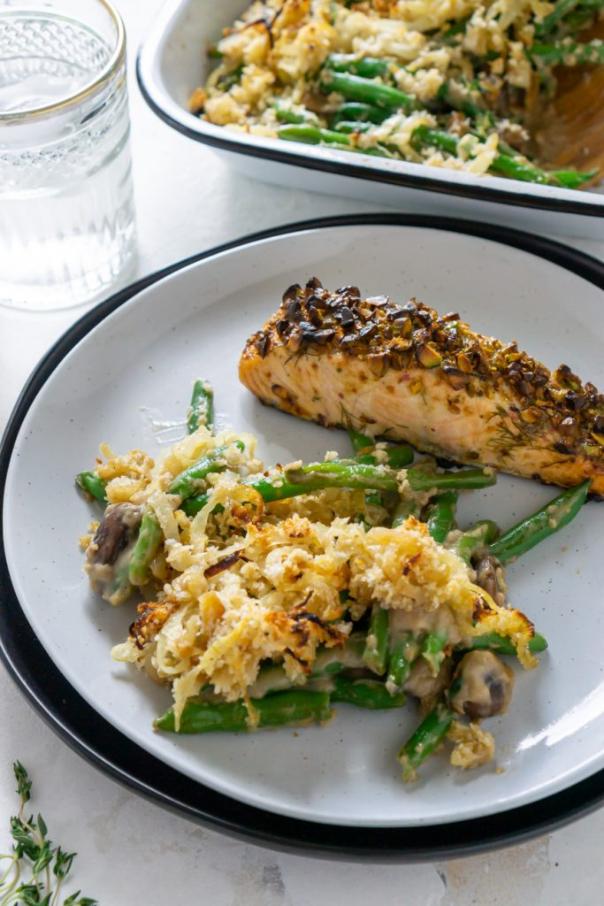 green bean casserole on a white plate with salmon