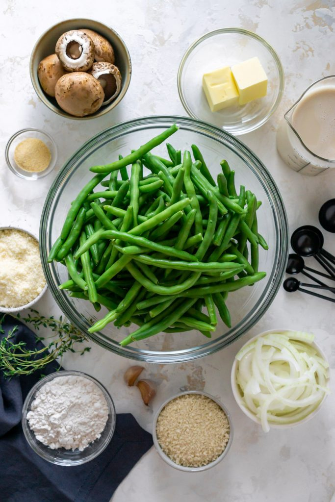 ingredients in small bowls - green beans, mushrooms, butter, onions, oat milk