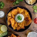 air fryer tortilla chips in a black bowl