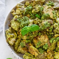 basil pesto chicken in a white bowl