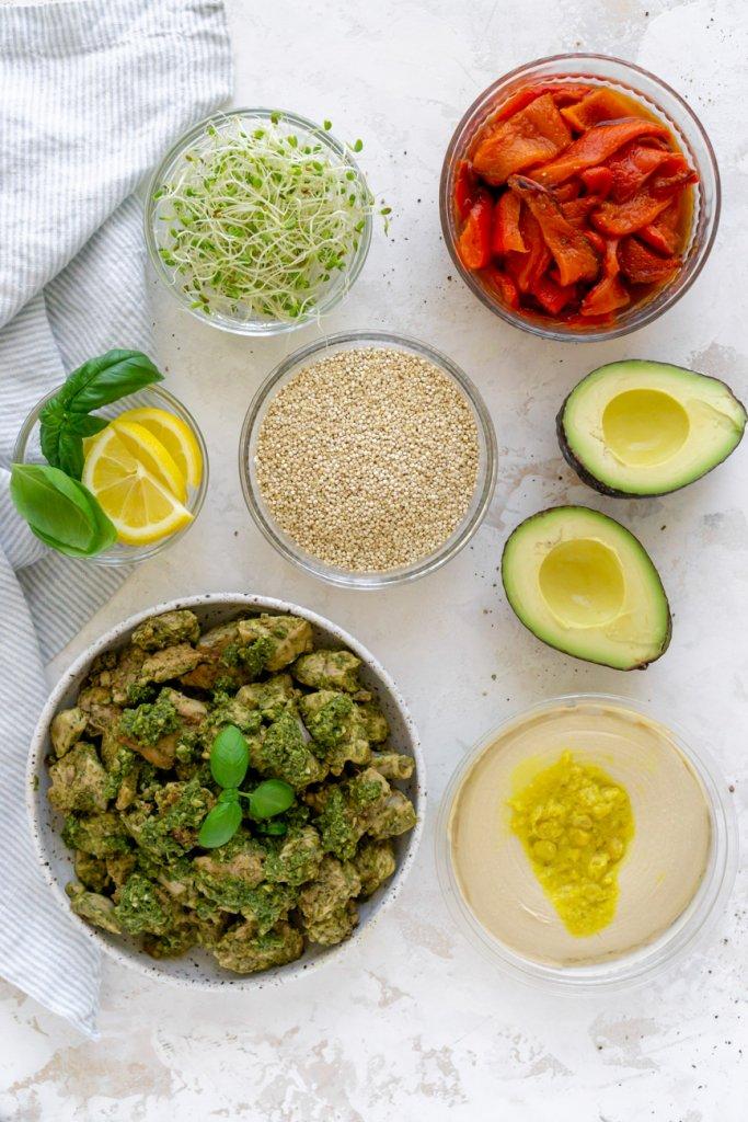 ingredients: pesto chicken, quinoa, avocado, red peppers, hummus, sprouts