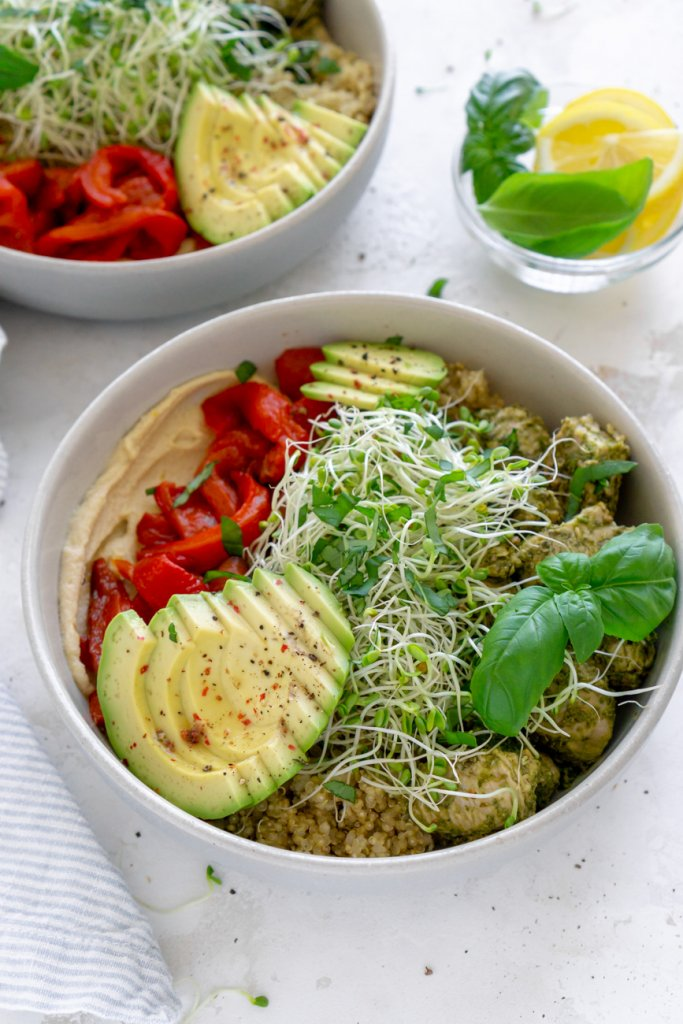 two chicken power bowls and lemon wedges