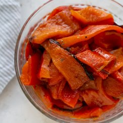 roasted red peppers in a glass bowl