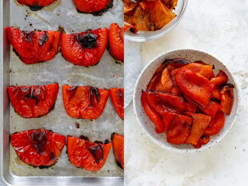 roasted red peppers on a sheet pan and in a white bowl